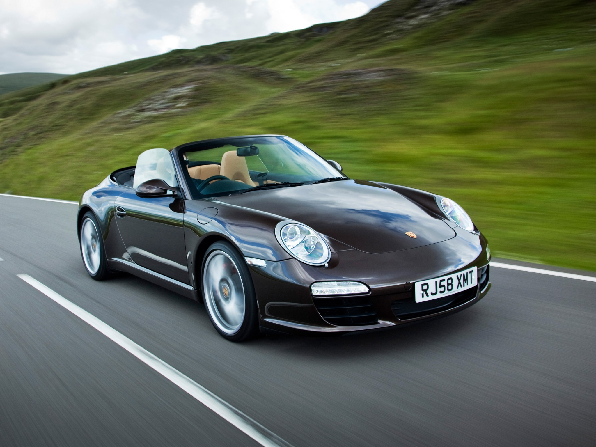 porsche 911 carrera s cabriolet 997 2008 2009 2010 2011 autoevolution. Black Bedroom Furniture Sets. Home Design Ideas
