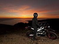 It's better to stop and admire the sunset than riding and not having your eyes on the road