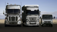 The Freightliner Cascadia C8 Truck, the new Mercedes-Benz Actros and the Fuso Canter (from left to right)