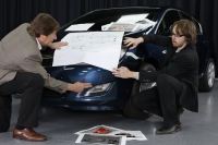 Astra's Lead Designer Marc van der Haegen and Engineering Coordinator Laszlo Kreth showing the new Astra