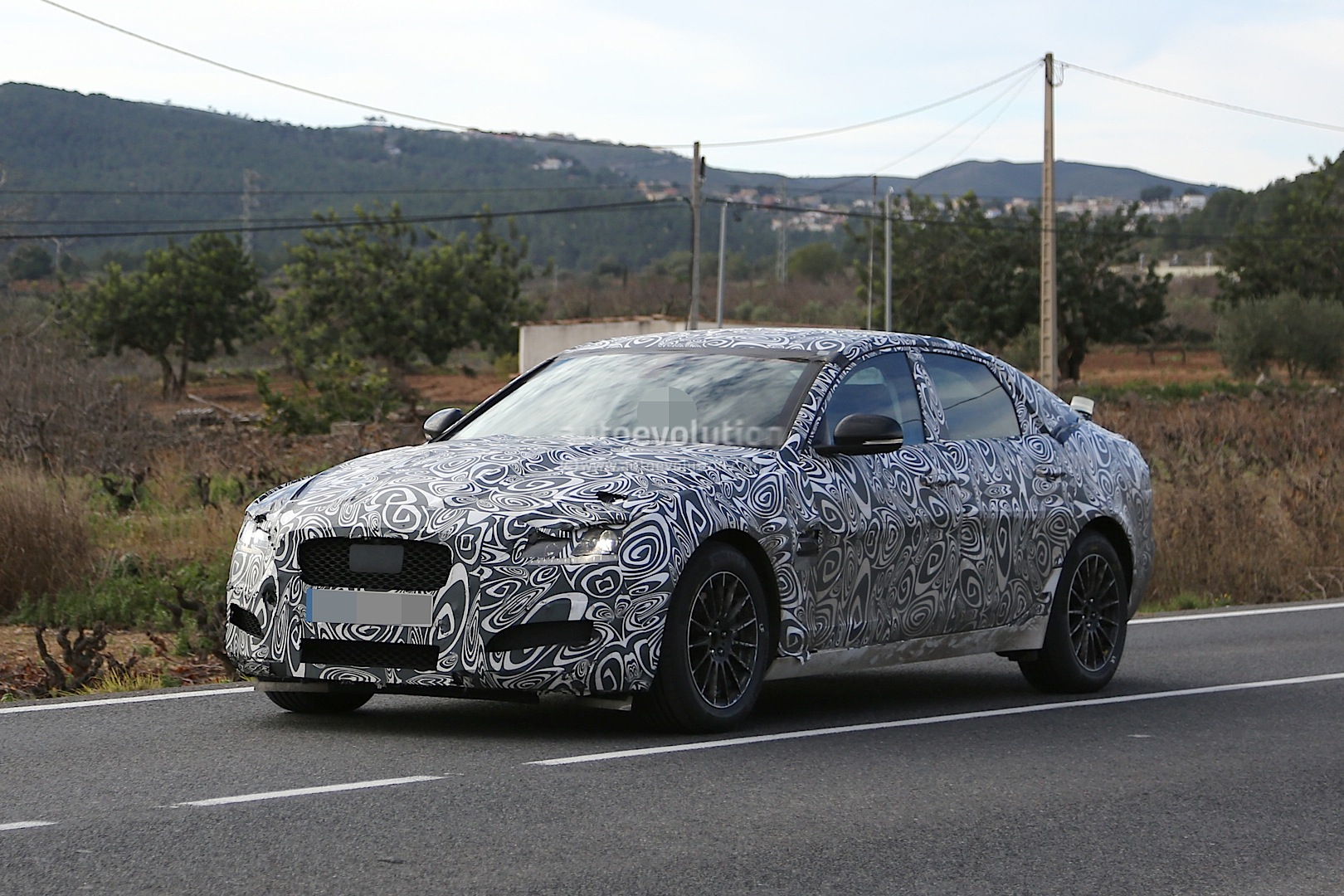 2015 jaguar xf spied with curious looking tail pipes. Black Bedroom Furniture Sets. Home Design Ideas