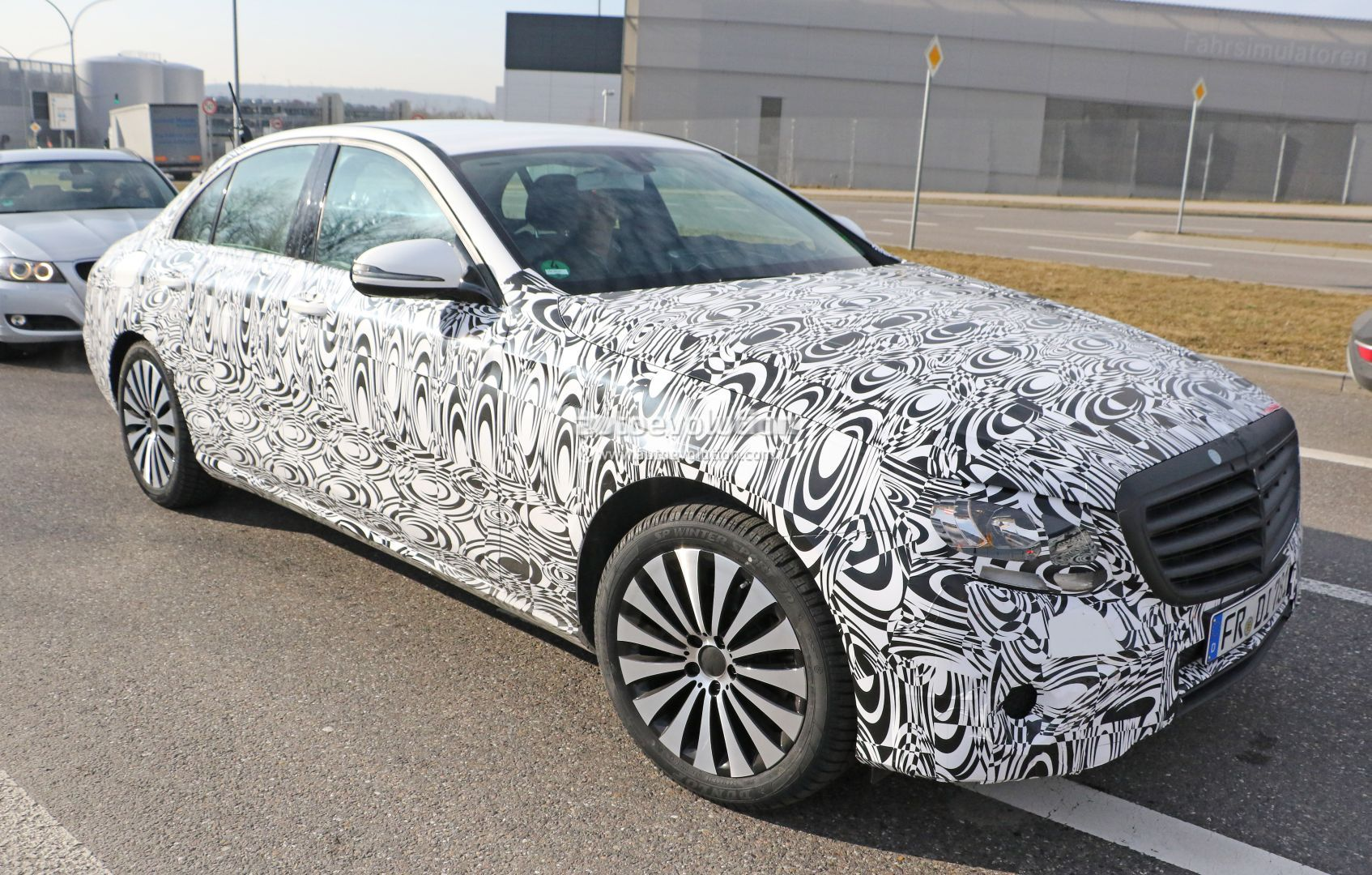 2017 Mercedes Benz E Cl Drops Heavy Camouflage Reveals Silhouette In Latest Spyshots