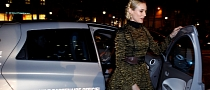Actress Diane Kruger Turns on Champs-Elysees Lights in Renault Zoe