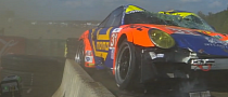 ALMS Series Porsche 911 Crashes Hard, Lands on Top of Tire Wall [Video]