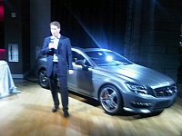 Ola Kallenius speaking in front of press members at the 2010 LA Auto Show