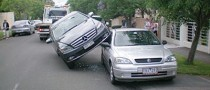 "Australian Woman ""Parks"" Her Mercedes on a Holden Astra"