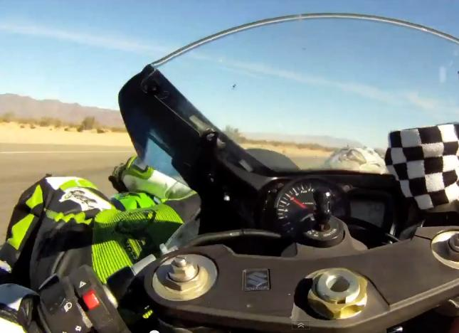 Bike Racers Collide and Crash on Circuit