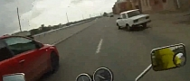 Biker Wrecks Car after Insanely Close Call [Video]