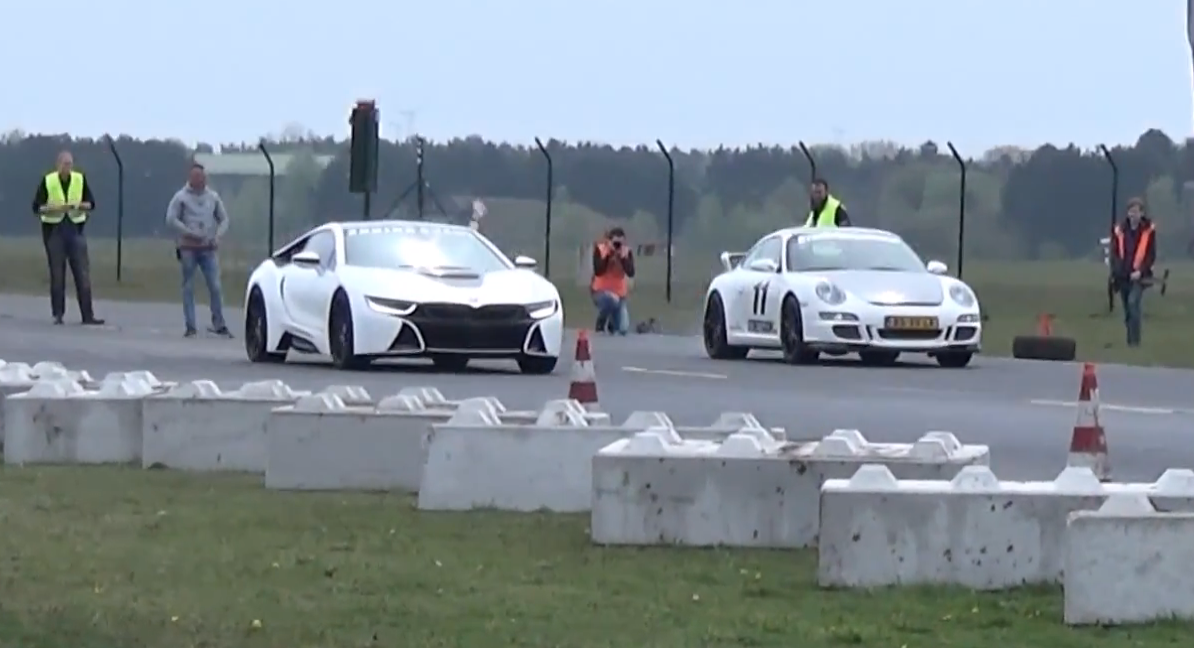Bmw I8 Tuned By Manhart Races Mercedes Benz C63 Amg And Porsche 911