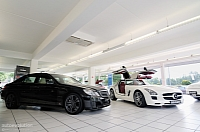 Brabus E V12 and SLS AMG chilling in the main showroom.