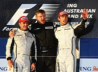 Ross Brawn and drivers Jenson Button and Rubens Barrichello after their winning start of the 2009 season