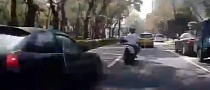 Car Chasing Scooter Crashes into Parked Vehicle [Video]