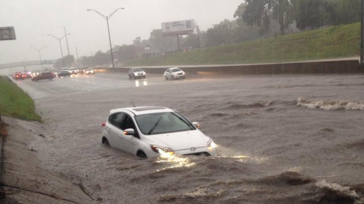Cars Trudge Through Detroit Flooding Ford Focus St