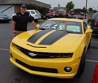 Jonathan Mason, of Frankenmuth, wins 2011 Chevy Camaro with a winning bid of $5.28.