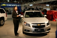 Karen Tour, Chevrolet Small Cars Marketing Manager of General Motors Middle East unveiling the Chevrolet Cruze at the 2008 Abu Dhabi Motor Show