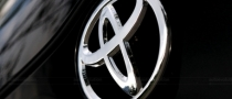 China Happy with Toyota, Ford Recall