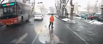 Chinese Kid Risks it All and Plays in Very Heavy Traffic [Video]
