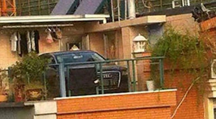 Chinese Woman Crane-Lifts Son-in-Law's Audi onto Roof