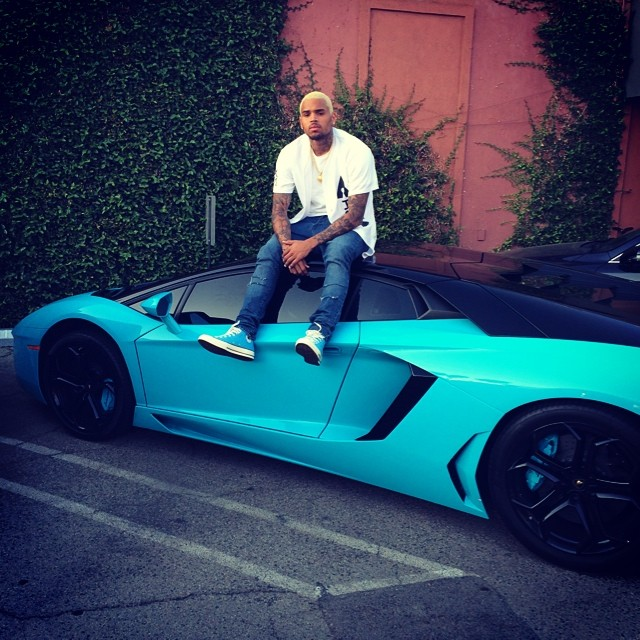 Chris Brown Wears Blue Sneakers While Sitting On His Sky