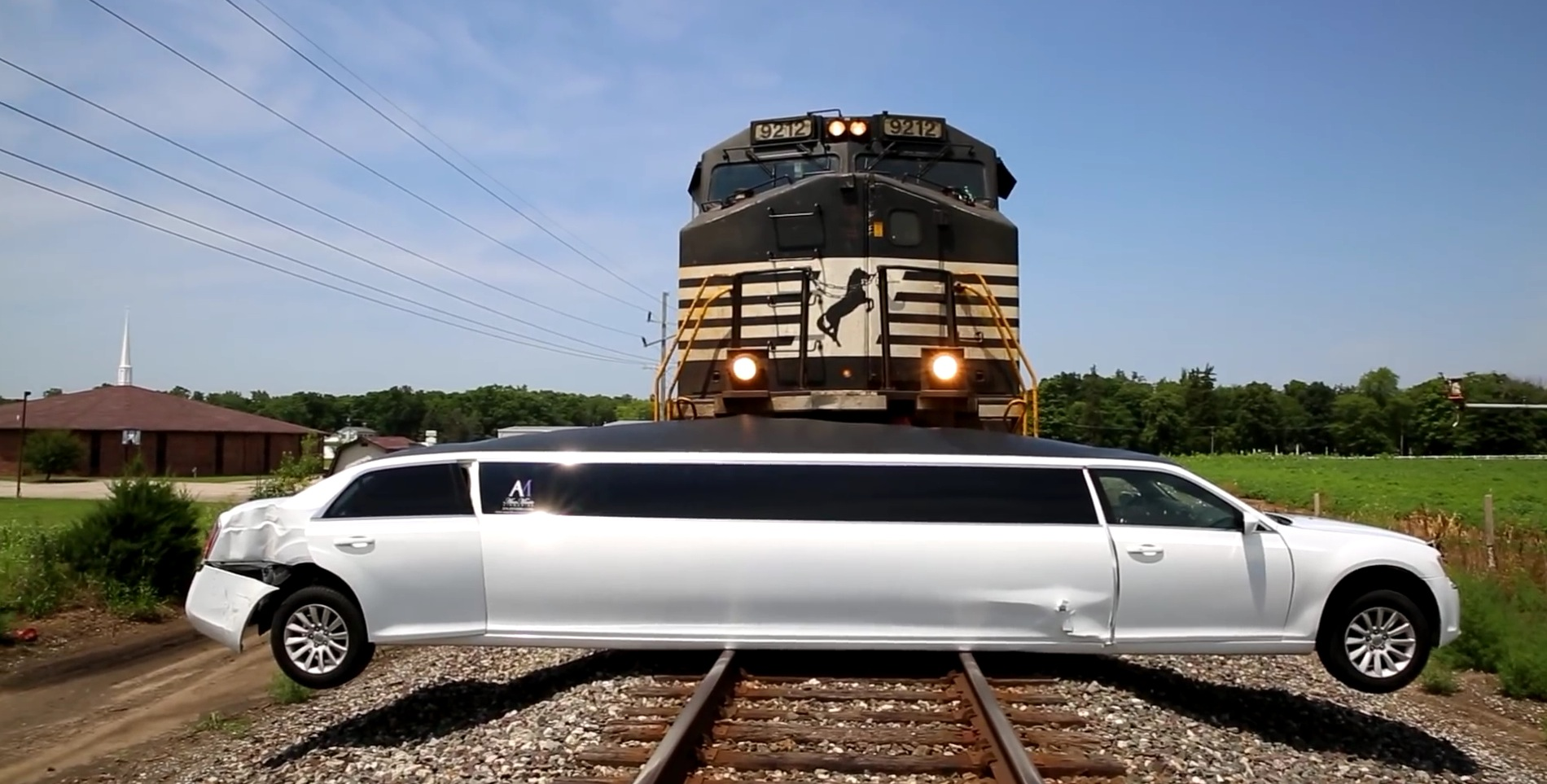 Chrysler Limo Suspended On Tracks Makes For A Brutal Train - Chrysler 300 limo