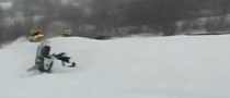 Crazy Double Snowmobile Crash for One Very Stupid Rider [Video]