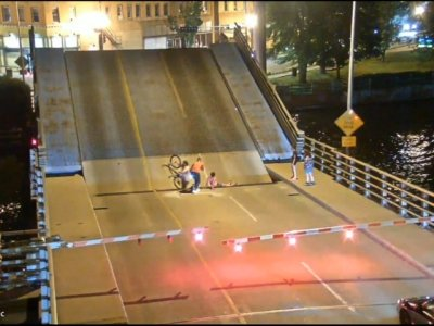 Cyclist falls into gap of rising bridge