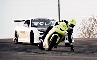 Insane motorcycle vs. car drift battle