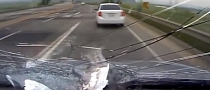 Driver Almost Gets Impaled by Wooden Spike [Video]