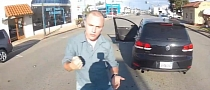 Driver Slaps Biker in Road Rage [Video]