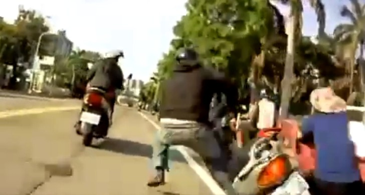 Dumb Scooter Rider Crashes into an Unsuspecting Cyclist [Video]