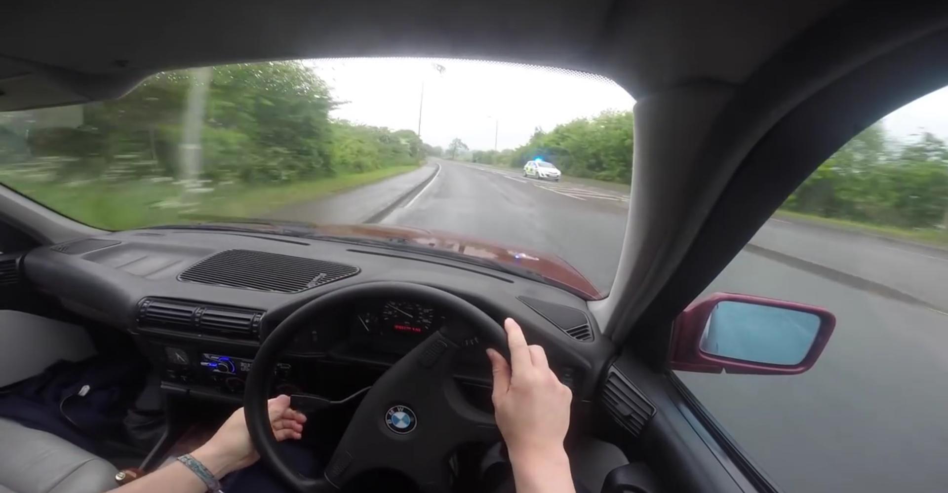 dumbass drifting a bmw inside a roundabout meets police car