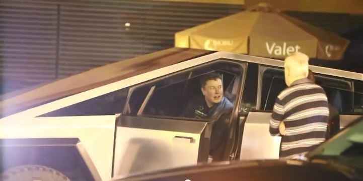 Tesla's Elon Musk runs over pylon while driving new Cybertruck
