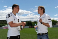Nico Rosberg and German striker Lukas Podolski