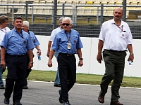 Charlie Whiting and some other FIA officials inspecting the track during a racing weekend