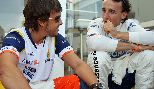 Photo of Robert Kubica & his friend, driver  Fernando Alonso