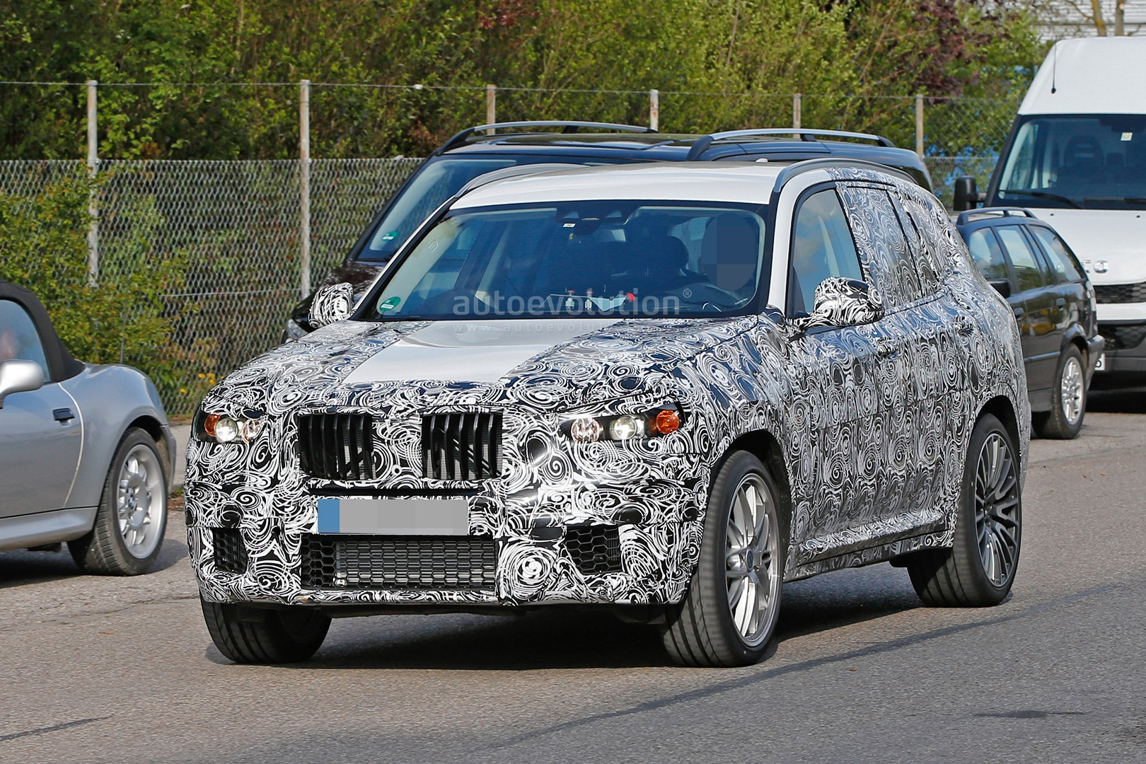 first ever bmw x3 m prototype spotted will compete with the glc 63 amg autoevolution. Black Bedroom Furniture Sets. Home Design Ideas