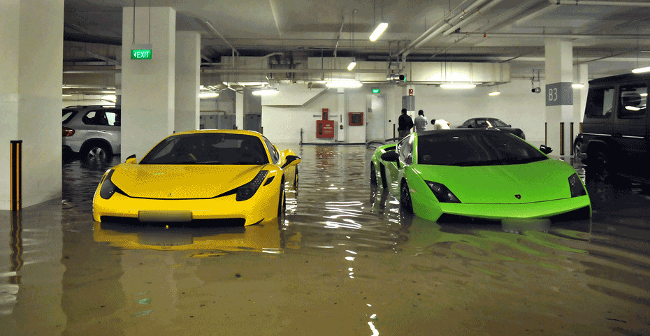 Flood damages exotic cars in singapore garage autoevolution for Garage autocash saint maur