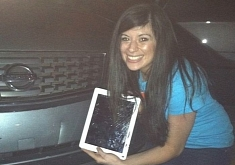 Flying iPad Gets Stuck in a Woman's Bumper [Video]