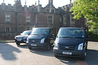 The vans are liveried in the distinctive colours of the Palace
