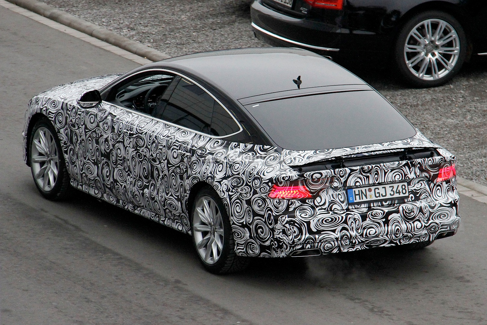 2014 - [Audi] A7 & S7 Sportback Restylée Spyshots-audi-a7-facelift-gets-new-headlight-design-1080p-5