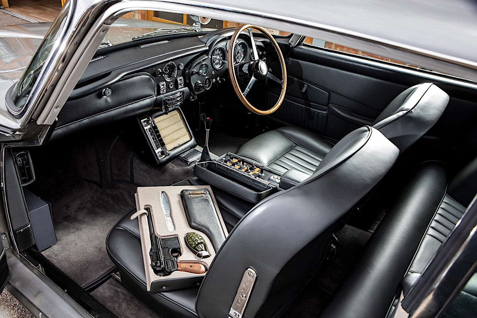 Bond's 1965 Aston Martin DB5 Pops Up in Retro-Styled Auction