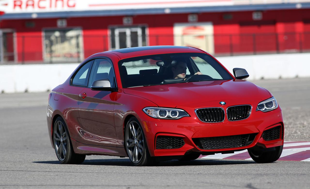 2014 bmw m235i review by car and driver autoevolution. Black Bedroom Furniture Sets. Home Design Ideas