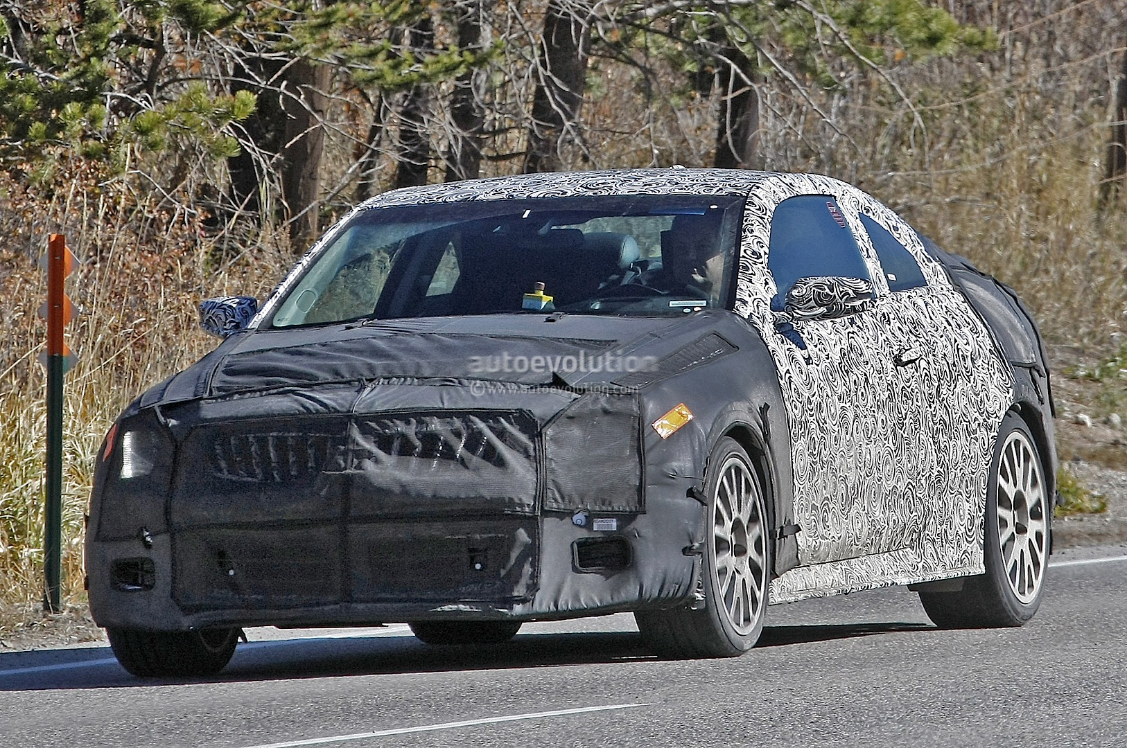 2015 cadillac ats v coupe spotted testing on mountainy roads video autoevolution. Black Bedroom Furniture Sets. Home Design Ideas