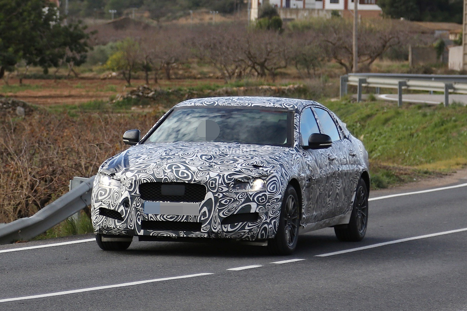 2016 - [Jaguar] XF II [X260] - Page 2 2015-jaguar-xf-spied-with-curious-looking-tail-pipes-photo-gallery_1