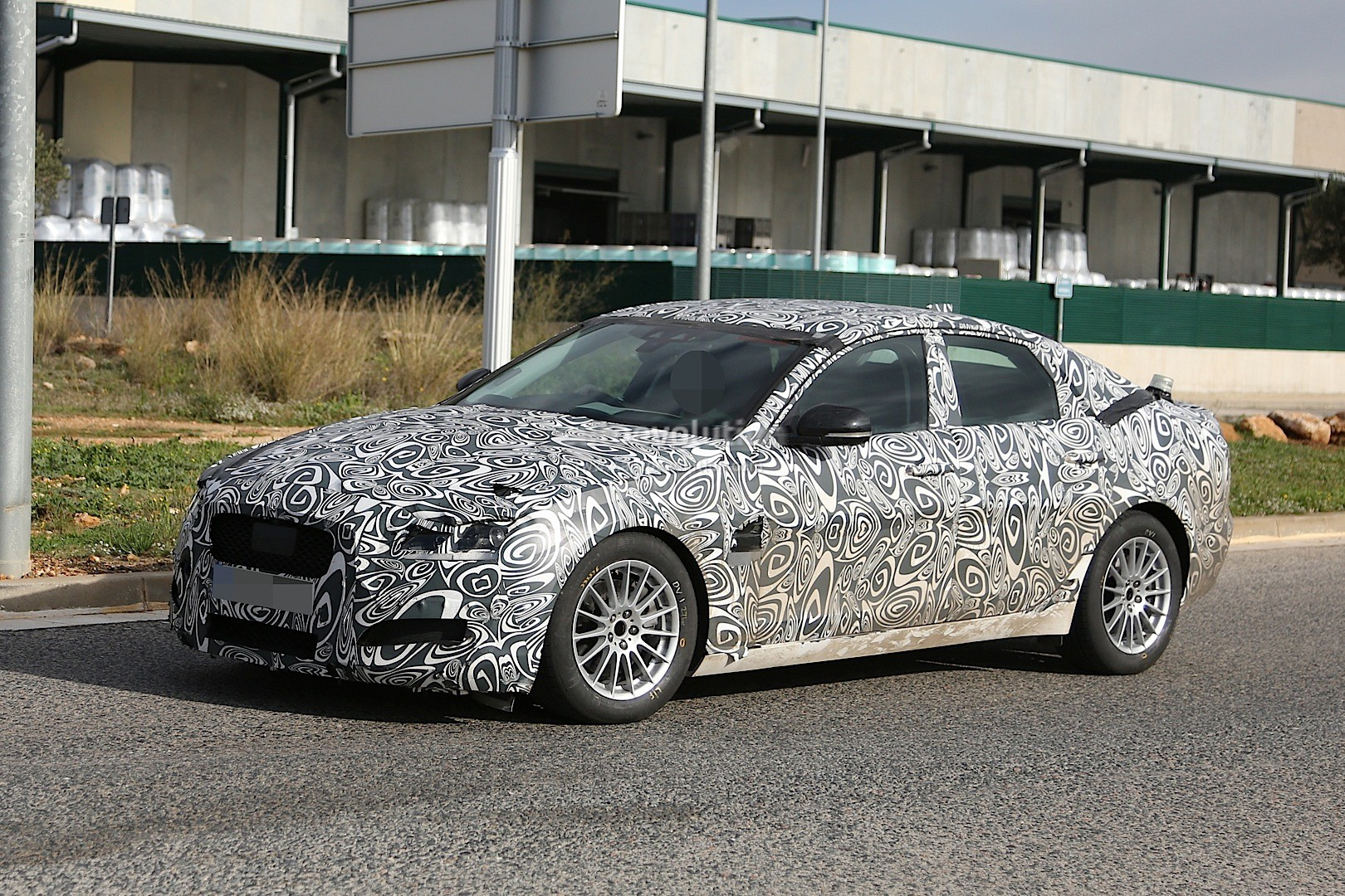 2016 - [Jaguar] XF II [X260] - Page 2 2015-jaguar-xf-spied-with-curious-looking-tail-pipes-photo-gallery_9