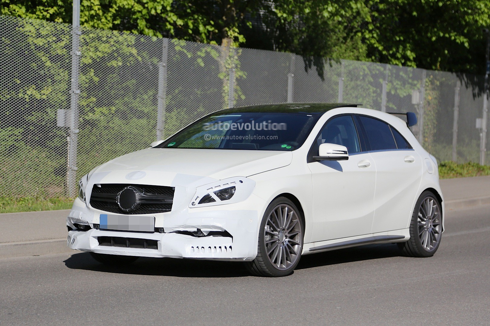 2016 mercedes a45 amg facelift spied with minimal disguise more aggressive design autoevolution. Black Bedroom Furniture Sets. Home Design Ideas