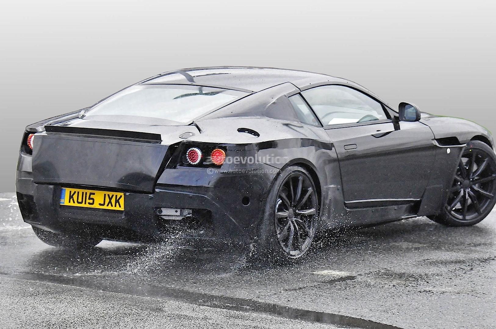 2016 - [Aston Martin] DB11 2017-aston-martin-db9-successor-prototype-spyshots-show-db10-like-silhouette-digital-dashboard-intercoolers_4