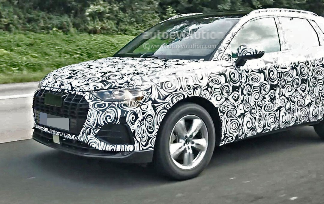 spyshots 2018 audi q3 has significantly less camo on production ready body autoevolution. Black Bedroom Furniture Sets. Home Design Ideas