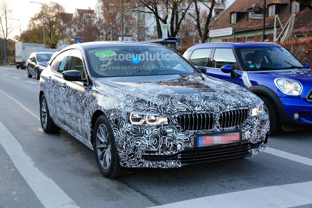 2018-bmw-6​-series-gt​-sheds-cam​o-reveals-​body-shape​-and-light​s_2