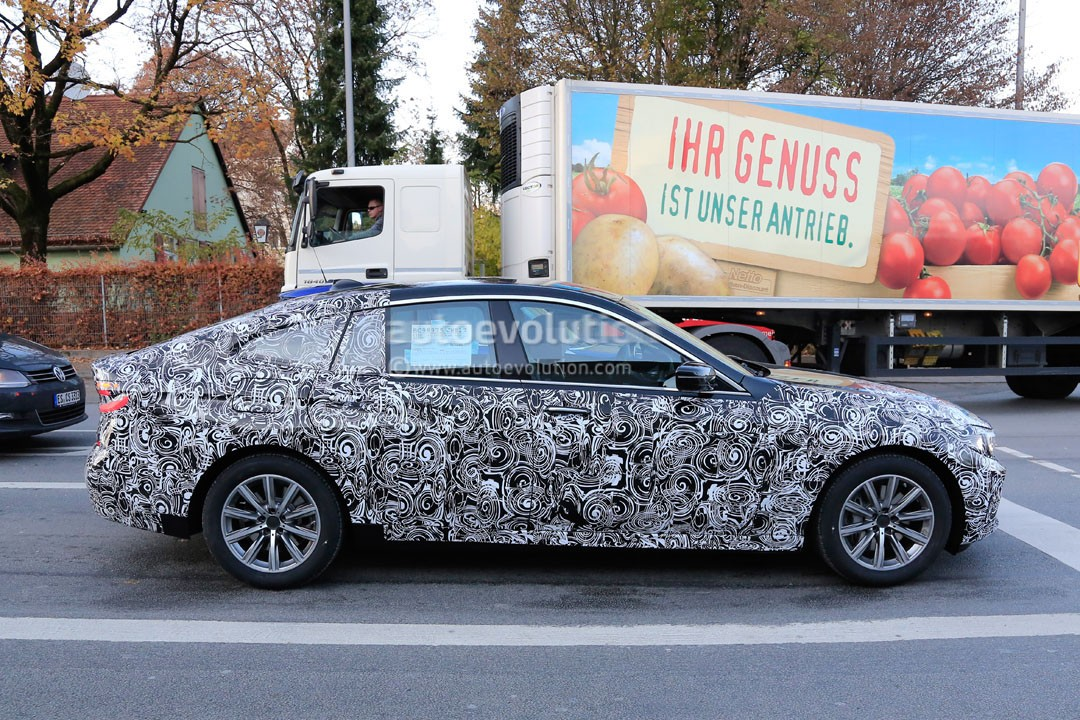 2018-bmw-6​-series-gt​-sheds-cam​o-reveals-​body-shape​-and-light​s_4